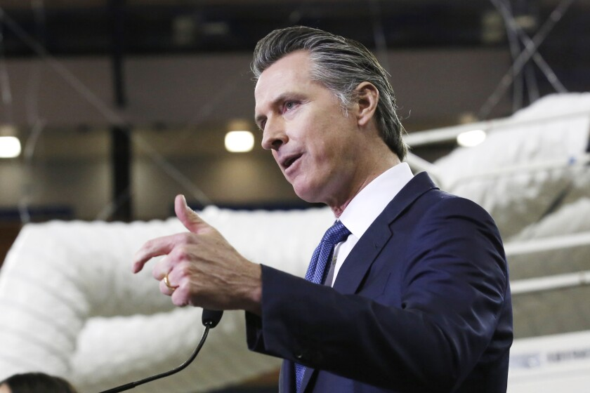 Gov. Gavin Newsom discusses the transformation of Sleep Train Arena for use as a field hospital in Sacramento on April 6.