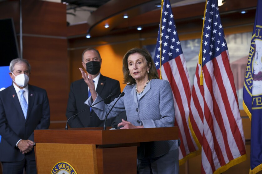 """Speaker of the House Nancy Pelosi, D-Calif., joined from left by House Budget Committee Chair John Yarmuth, D-Ky., and House Intelligence Committee Chairman Adam Schiff, D-Calif., talks to reporters about the """"Protecting Our Democracy Act"""" which will curb the power of the president in an effort to rein in executive powers that they say President Donald Trump abused, at the Capitol in Washington, Tuesday, Sept. 21, 2021. (AP Photo/J. Scott Applewhite)"""