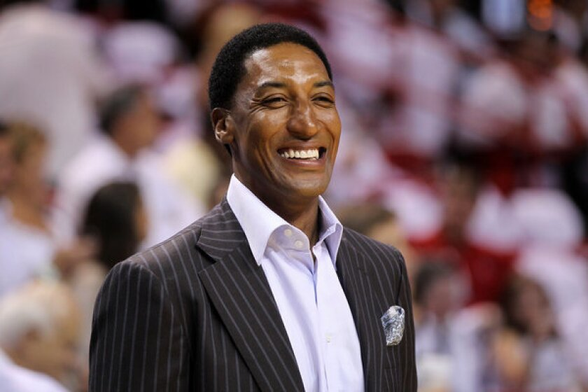 Former Chicago Bulls star Scottie Pippen watches as the Bulls play the Miami Heat during the 2011 NBA playoffs.