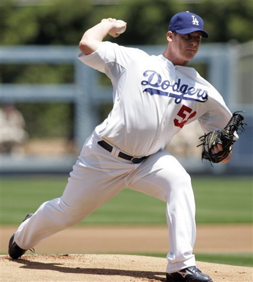 Los Angeles Dodgers starting pitcher Chad Billingsley works against the San Diego Padres during the first inning of a baseball game in Los Angeles, Sunday, May 3, 2009. (AP Photo/Lori Shepler).