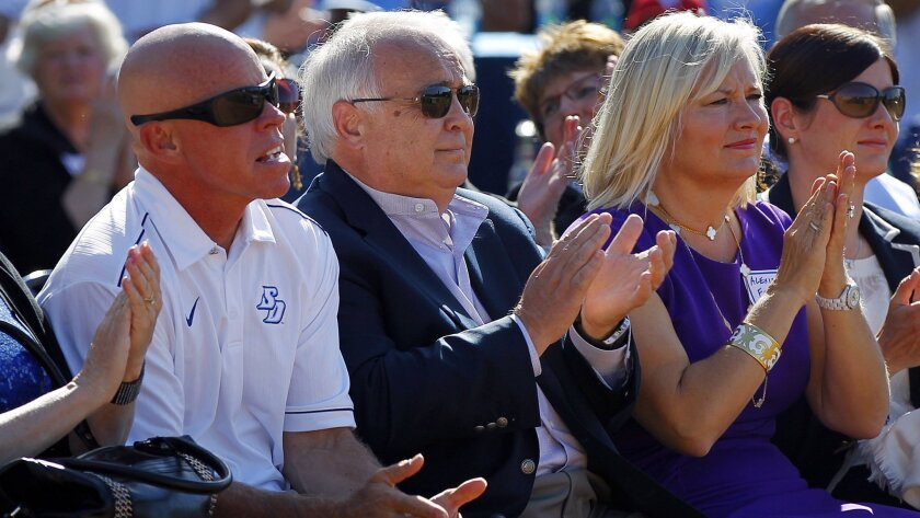 USD baseball coach Rich Hill (left), with Padres owner Ron Fowler and Fowler's wife Alexis.