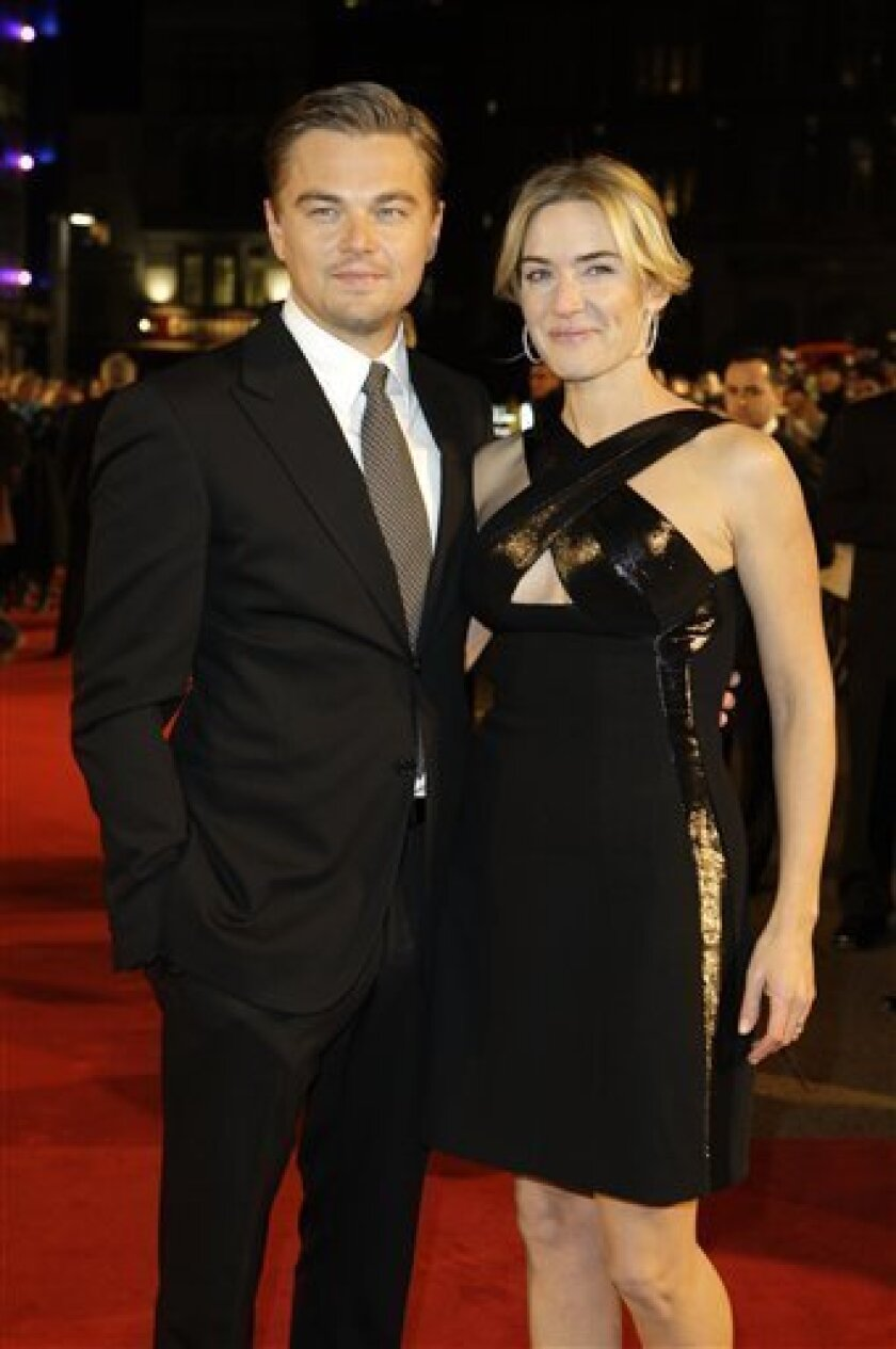British actress Kate Winslet and U.S actor Leonardo DiCaprio, arrives on the red carpet for the European premiere of Revolutionary Road, at a central London cinema, Sunday, Jan. 18, 2009. (AP Photo/Joel Ryan)
