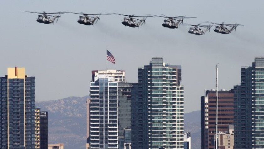 U.S. Marine Corps CH-53 helicopters fly in formation over downtown San Diego during the Navy's 100th anniversary celebration of Naval Aviation.