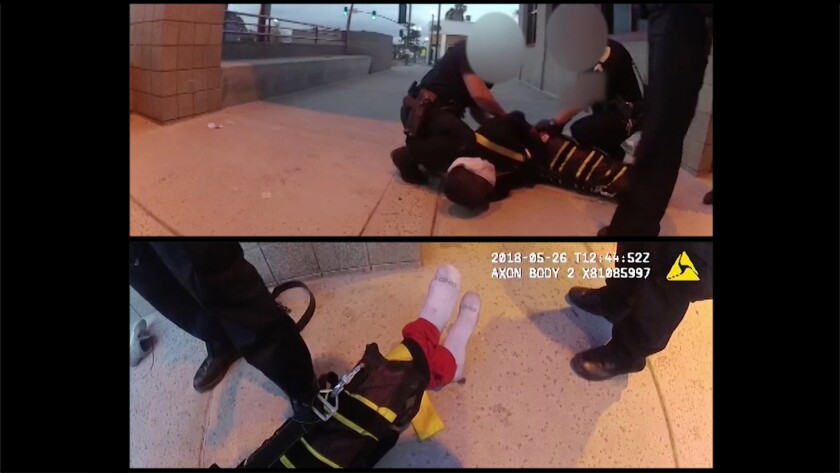 Screen shot from video released by the district attorney shows Earl McNeil handcuffed and restrained by The Wrap, a device police departments across the country are using to restrain subjects.