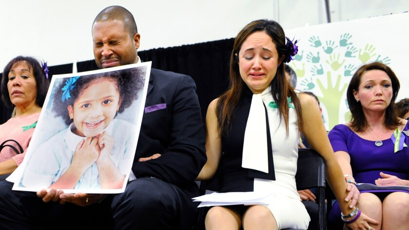 Nelba Marquez-Greene and her husband with a picture of their daughter, Ana Grace.