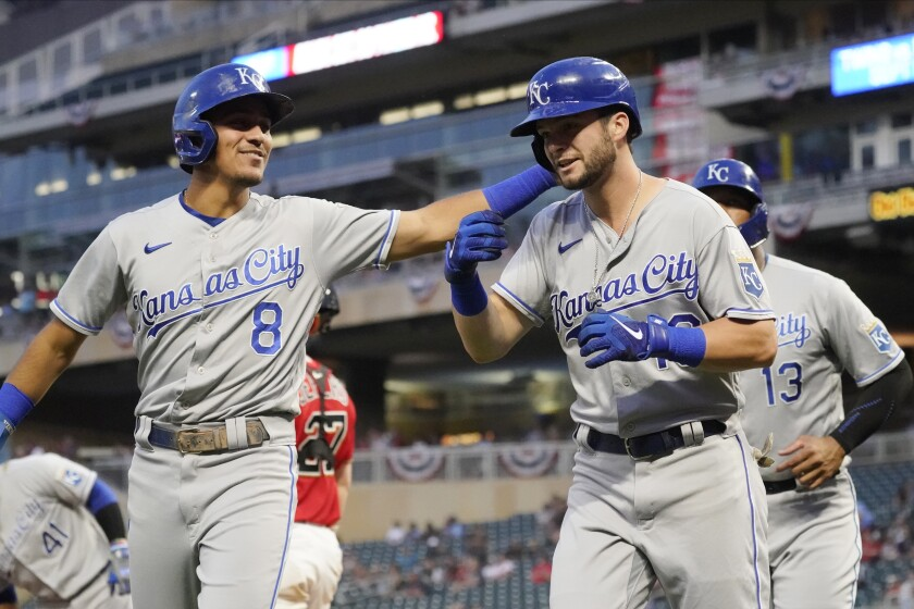 Kansas City Royals' Andrew Benintendi, right, is congratulated by Nicky Lopez (8) following Benintendi's three-run home run off Minnesota Twins pitcher Griffin Jax during the first inning of a baseball game Friday, Sept. 10, 2021, in Minneapolis. (AP Photo/Jim Mone)