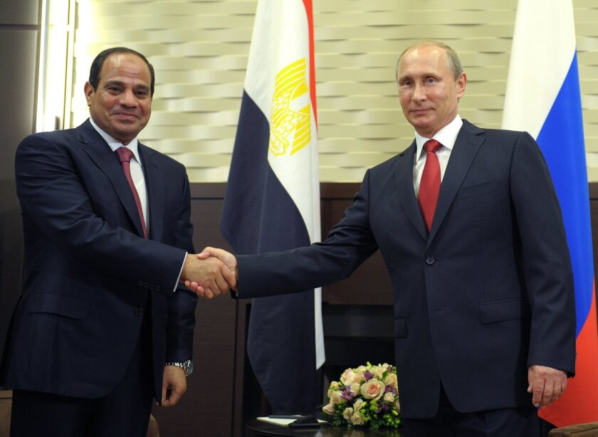 Russian President Vladimir Putin, right, and Egyptian President Abdel-Fattah el-Sissi shake hands during a meeting in the Russian Black Sea resort of Sochi, Russia, Tuesday, Aug. 12, 2014. Egyptian President Abdel-Fattah el-Sissi arrived in Russia on Tuesday for his first official visit as president and was immediately shown a selection of Russian military hardware for sale. (AP Photo/RIA Novosti, Alexei Druzhinin, Presidential Press Service)