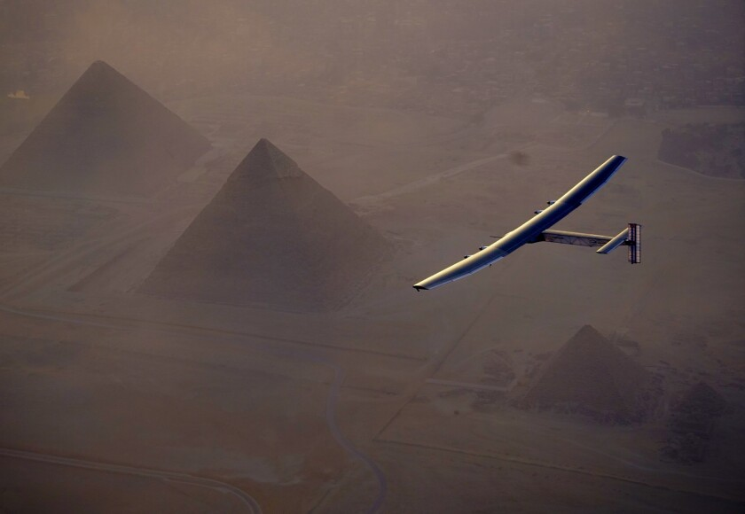 The Solar Impulse 2 flies over the pyramids outside Cairo on July 13.