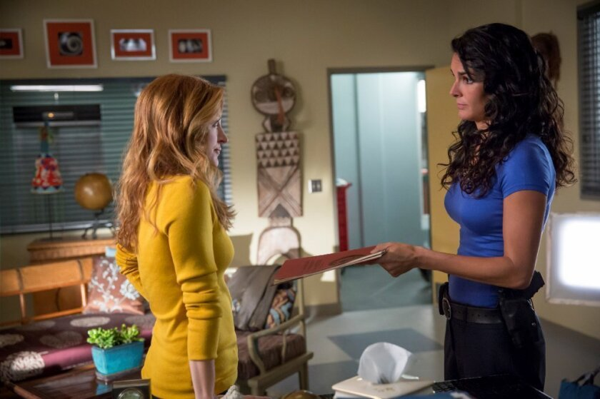 """Rizzoli and Isles,"" starring Sasha Alexander, left, Angie Harmon, is a hit for TNT."
