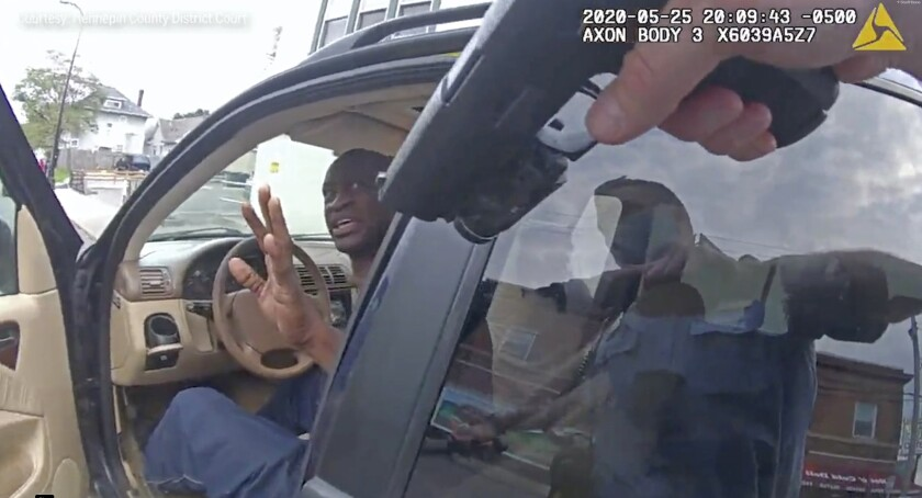 Minneapolis Police Officer Thomas Lane points his gun at George Floyd in body camera video.