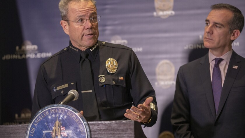 Mayor Eric Garcetti, right, during a press conference with LAPD Chief Michel Moore on Monday.