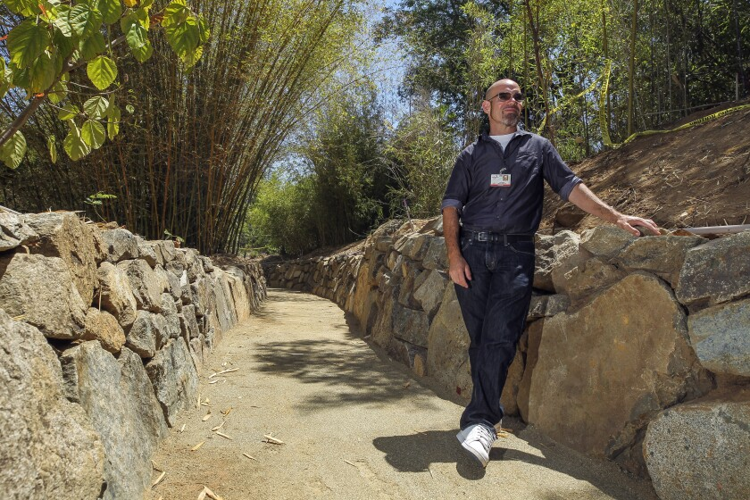 Tony Rangel, ground services supervisor for Palomar College, gives a sneak peak tour of the new ADA-compliant trails in the campus's Edwin & Frances Hunter Arboretum in San Marcos on Tuesday, Aug. 6. The arboretum will reopen to the public on Sept. 26.