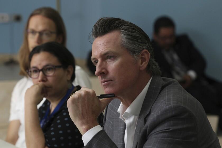 California Gov. Gavin Newsom during a meeting at the Divina Providencia Hospital facility in San Salvador on April 9.