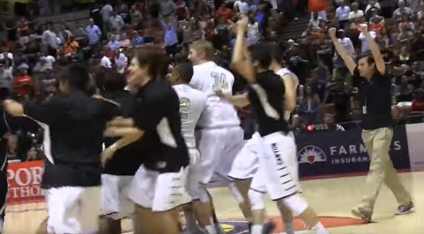 Anaheim Canyon players celebrate after rallying from a 22-point fourth-quarter deficit to defeat Lawndale, 103-98, in double overtime in the 2015 Division 2AA championship game.