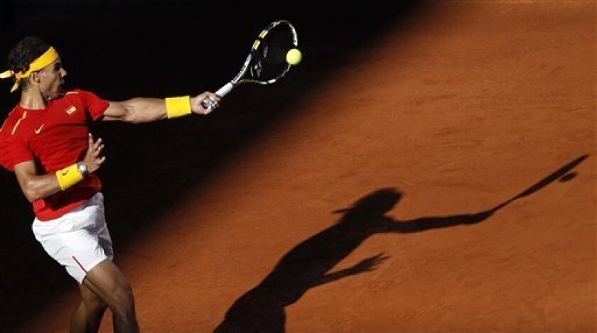 Spain's Rafael Nadal returns the ball towards Ukraine's Sergiy Stakhovky on the first day of the World Group play-off Davis Cup tennis in Madrid, Spain, Friday, Sept. 13, 2013. (AP Photo/Andres Kudacki)