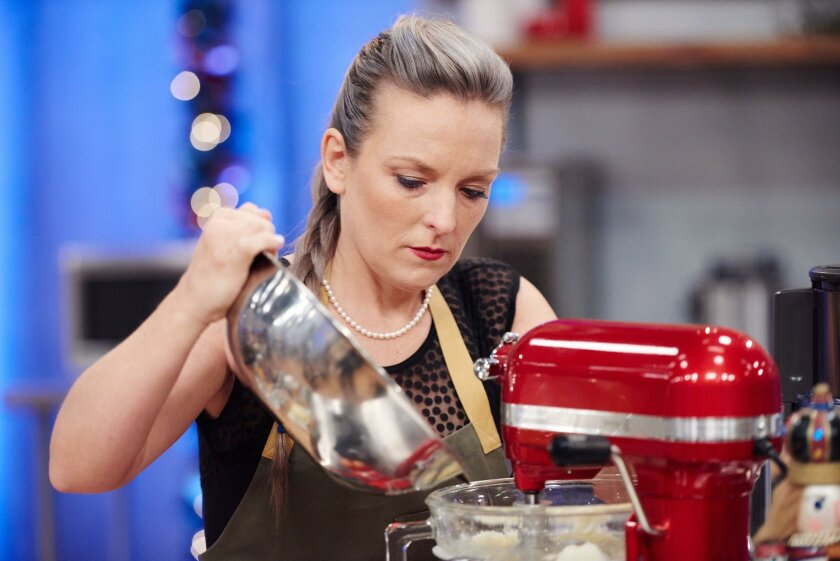 """Maeve Rochford prepares her cake during a segment of Food Network's """"Holiday Baking Championship."""""""