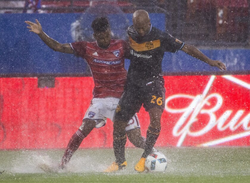 FC Dallas midfielder Kellyn Acosta (23) fights Houston Dynamo midfielder Collen Warner (26) for the ball during the first half of a MLS soccer game on Thursday, June 2, 2016, in Frisco, Texas.  (Ashley Landis/The Dallas Morning News via AP) MANDATORY CREDIT; MAGS OUT; TV OUT; INTERNET USE BY AP MEM