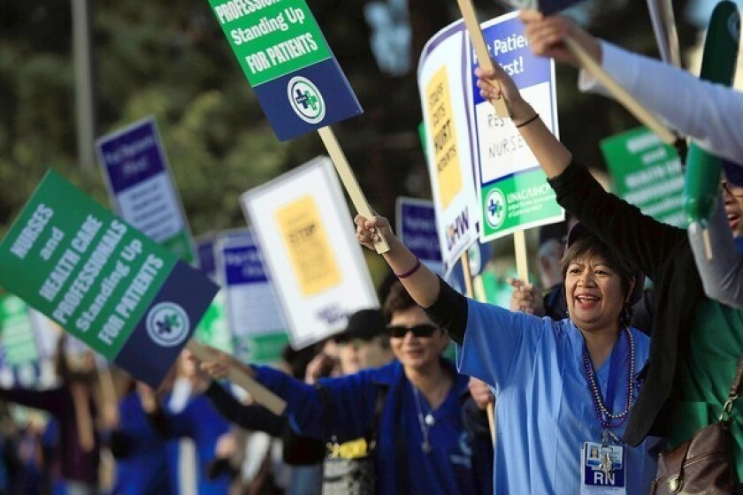 Nurses and other medical professionals protest outside Kaiser Permanente South Bay Medical Center in Harbor City last year. Labor advocates say California could serve as a blueprint for unions across the country as they seek to stem membership declines.