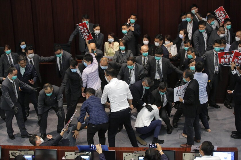 A scuffle during a Legislative Council's House Committee meeting in Hong Kong