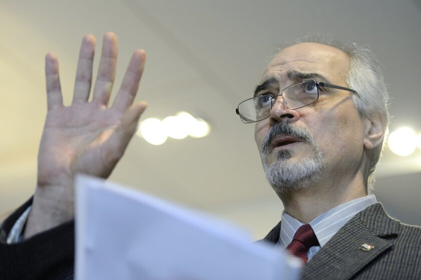 "Syrian chief negotiator and the country's ambassador to the U.N. Bashar Ja'afar, right, holds a press conference during the round of negotiations between the Syrian government and the opposition in Geneva, Switzerland, Sunday, Jan. 31, 2016. The U.N. Special Envoy to Syria Staffan de Mistura says he is ""optimistic and determined"" describing indirect peace talks between the government and the opposition as ""a historic occasion"" to end the country's civil war. (Martial Trezzini\Keystone via AP)"