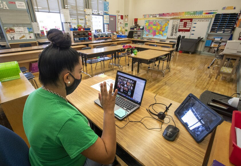 Gladys Alvarez, a fifth-grade teacher, waves goodbye to her students at conclusion of a virtual meet and greet last week.