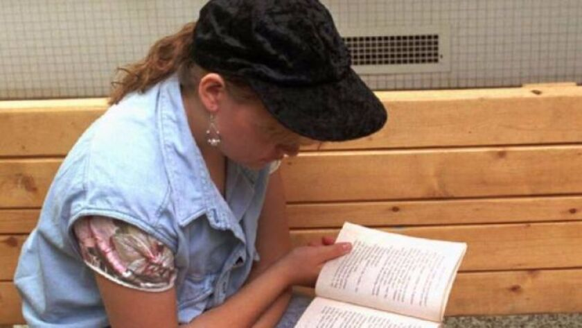 """File photo of student reading. Carlsbad Unified School District is offering a workshop on """"habits of mind"""" for successful students"""