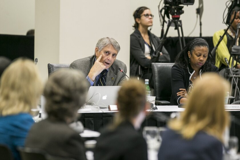 Alumni Regents Rod Davis, left, and Yolanda Gorman address the University of California's Board of Regents meeting to discuss a controversial policy statement on intolerance at UC Irvine on Sept. 17.