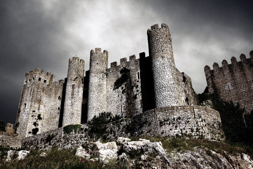 medieval castle at night with stormy sky