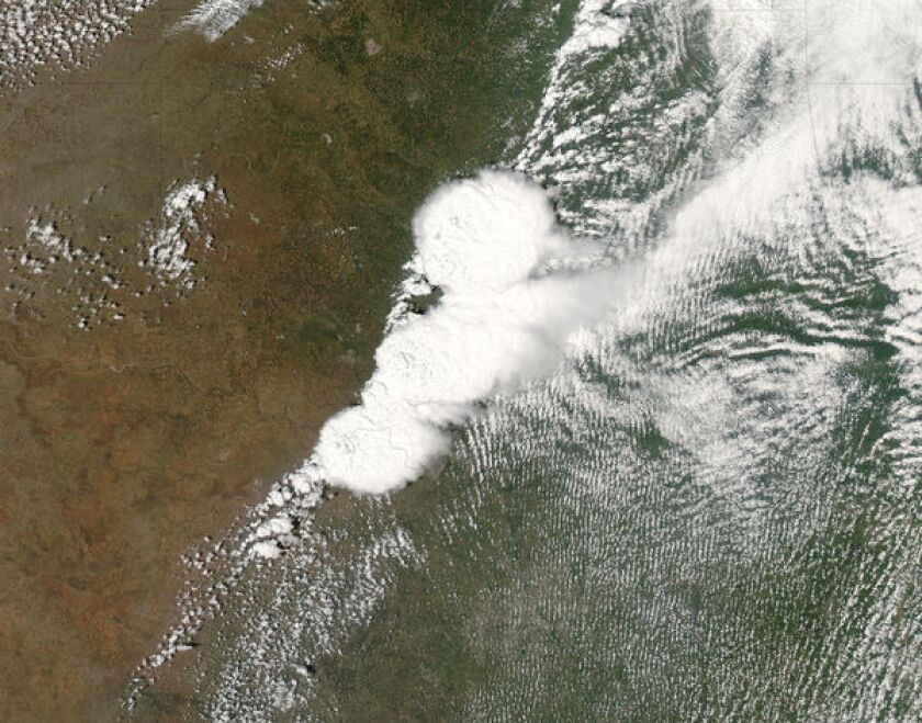 NASA's MODIS satellite captures the storm system that generated a EF4 tornado -- distinguished by the thick cord of clouds at the center -- as it hit Moore, Okla.