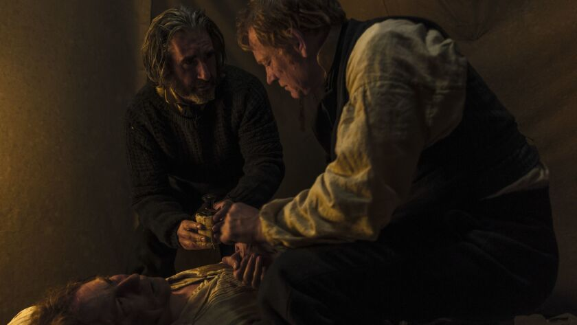 Caption info: (From right to left)Jared Harris as Francis Crozier, John Lynch as John Bridgens, and