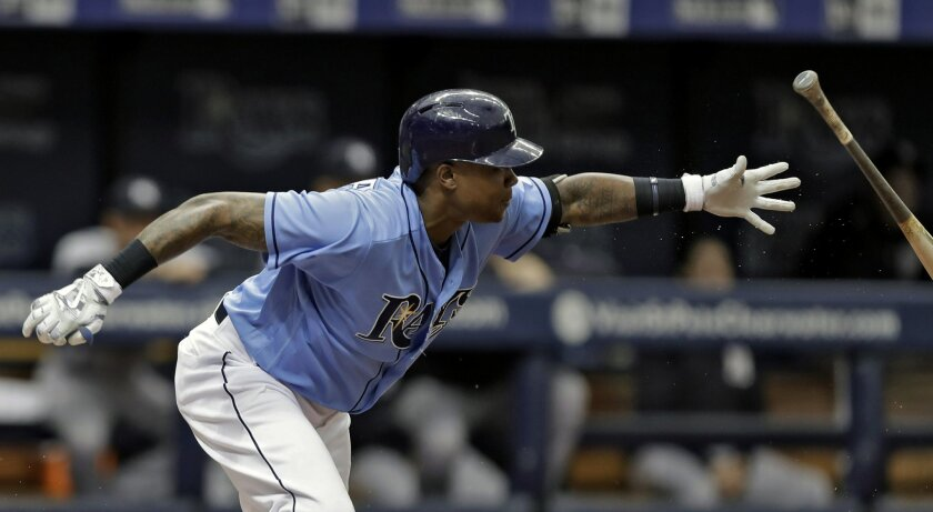 Tampa Bay Rays' Tim Beckham flips his bat on an RBI-ground out off New York Yankees starting pitcher Michael Pineda during the fourth inning of a baseball game Sunday, July 31, 2016, in St. Petersburg, Fla. Rays' Steven Souza Jr. scored. (AP Photo/Chris O'Meara)
