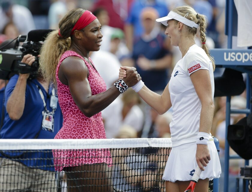 FILE - In this Friday, Sept. 5, 2014, file photo, Serena Williams, left, greets Ekaterina Makarova, of Russia, after winning their semifinal match of the 2014 U.S. Open tennis tournament in New York. Williams starts her bid for a record 23rd major title with a tough first-round matchup at the U.S.
