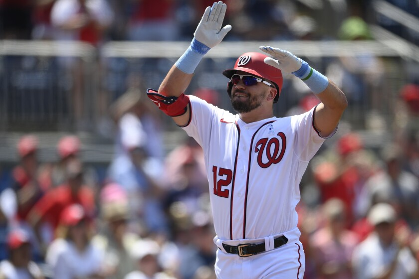 Washington Nationals' Kyle Schwarber celebrates his home run during the fifth inning of a baseball game against the New York Mets, Sunday, June 20, 2021, in Washington. (AP Photo/Nick Wass)