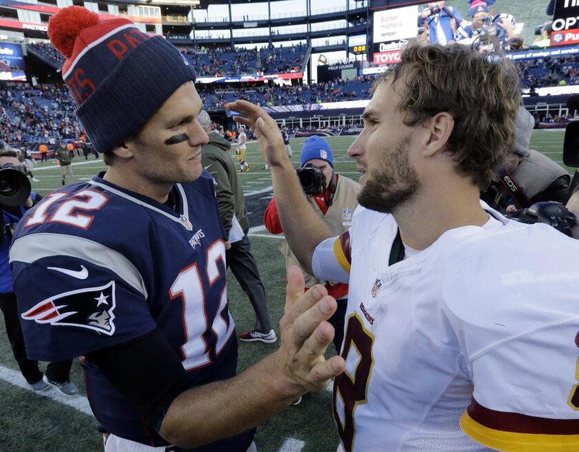 New England Patriots quarterback Tom Brady (12) and Washington Redskins quarterback Kirk Cousins (8) speak at midfield after the Patriots' 27-10 win in an NFL football game, Sunday, Nov. 8, 2015, in Foxborough, Mass. (AP Photo/Steven Senne)