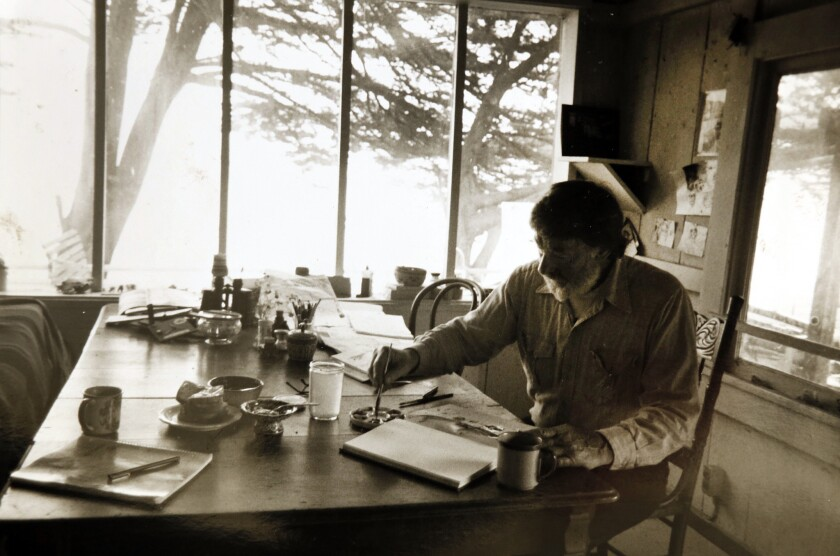 An undated photo of Clayton Lewis at work in his studio at Laird's Landing in the Point Reyes National Seashore. The fisherman, artist, and resident bohemian eked out a living for 31 years before he died there in 1995.