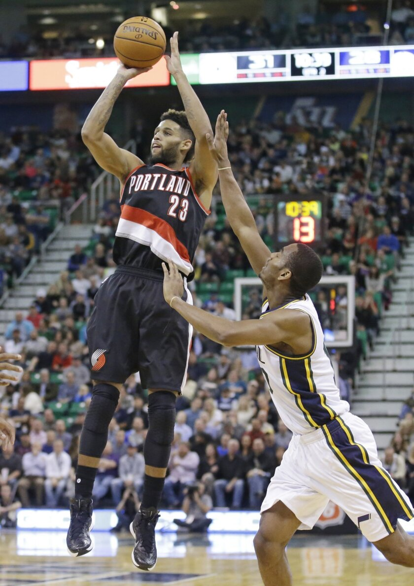Portland Trail Blazers forward Allen Crabbe (23) shoots as Utah Jazz guard Alec Burks, right, defends in the second quarter during an NBA basketball game Wednesday, Nov. 4, 2015, in Salt Lake City. (AP Photo/Rick Bowmer)