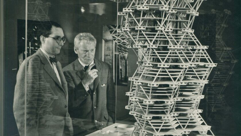 Louis Kahn (right) in front of a model of the City Tower Project in a 1958 exhibition at Cornell University. The project was never built.