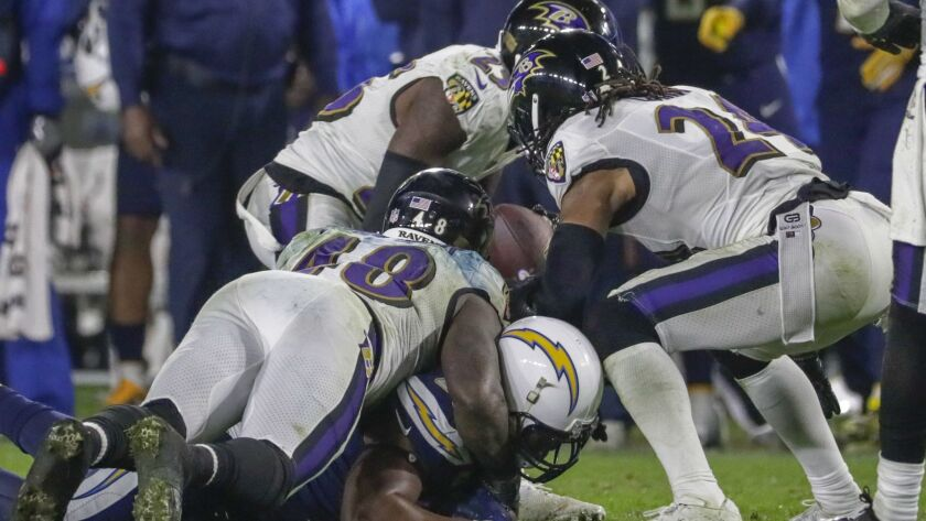 Ravens cornerback Tayvon Young takes the ball from Chargers tight end Antonio Gates and returns it for a touchdown late in the fourth quarter at StubHub Center.