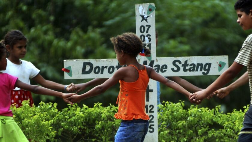Children play next to the place where American nun Dorothy Stang was killed in Anapu, Brazil, in Nov