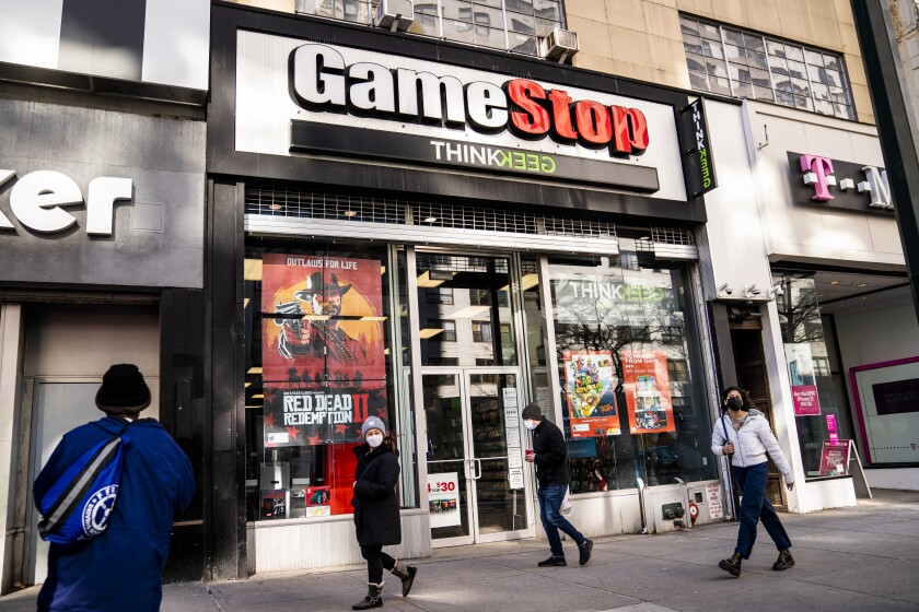 FILE - Pedestrians pass a GameStop store on 14th Street at Union Square, Thursday, Jan. 28, 2021, in the Manhattan borough of New York. GameStop shares are on track for their biggest one-day loss ever, extending a skid that's cleaved off some of its recent blockbuster gains following a social-media led campaign to get the videogame retailer's stock to skyrocket. Shares were down 46% to about $120 in morning trading Tuesday, Feb. 2, following a 31% decline a day earlier. (AP Photo/John Minchillo, File)