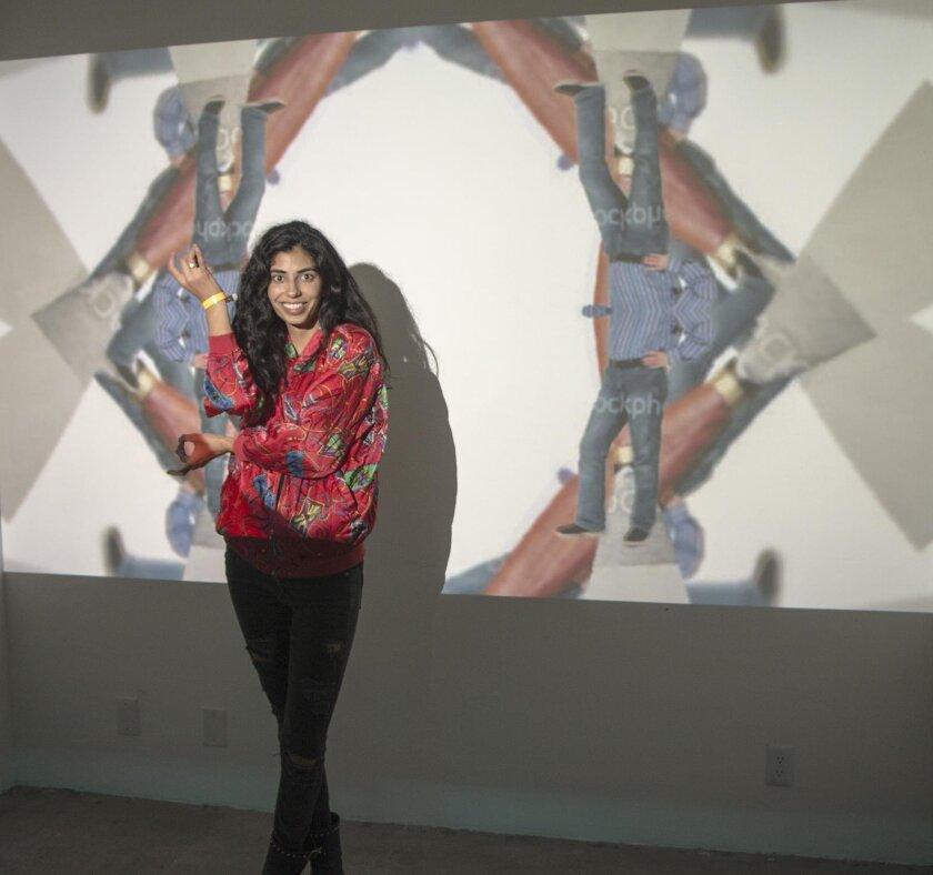 Bishop's School student/art-lover Shabham Maghavi in front of Institute for New Feeling's video