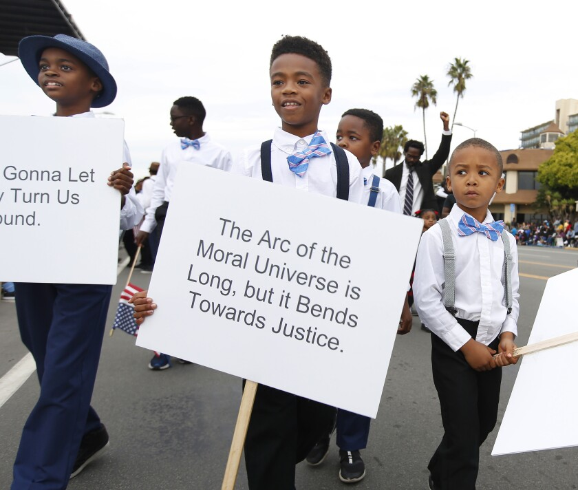 Children from Jack and Jill of America, Inc., San Diego Chapter, walk down Harbor Blvd during the 40th Annual Martin Luther King Jr. Day Parade on Jan. 19, 2020.