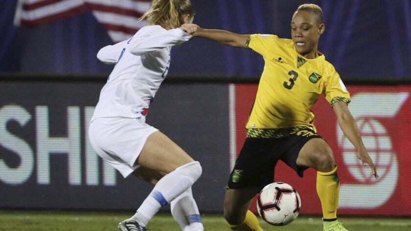 Emily Sonnett, left, of the United States defends against midfielder Shanise Foster of Jamaica during the second half of a CONCACAF Women's Championship semifinal game Sunday in Frisco, Texas. The U.S. won 6-0.
