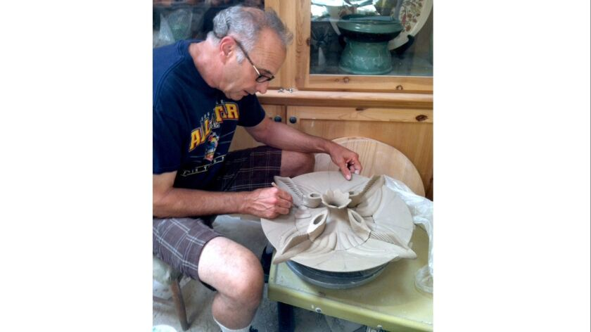 Ceramicist Michael Hirsh creates an art piece in his home studio in Burbank. (Courtesy Michael Hirsh