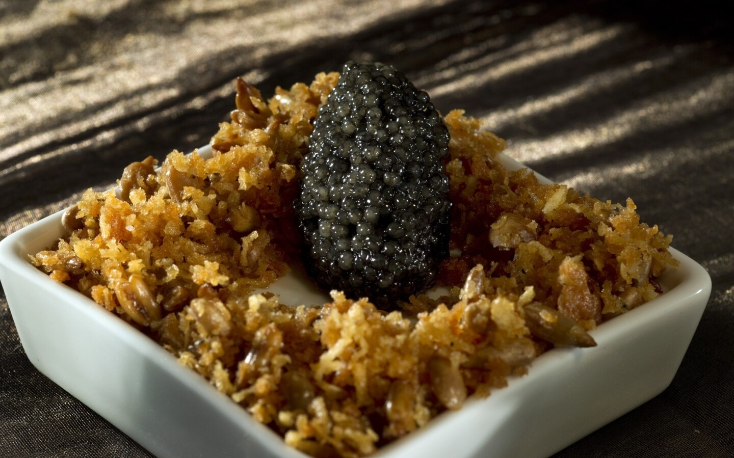 Rich and nutty yet subdued, a sunchoke and leek panna cotta lets the flavors of paddlefish caviar shine.