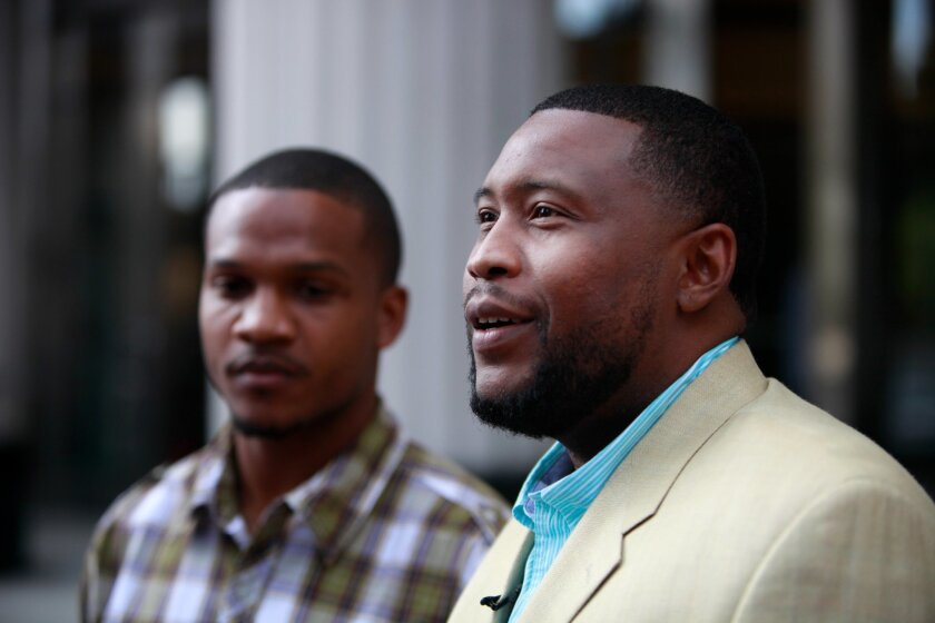 "Rapper Brandon ""Tiny-Doo"" Duncan, right, and Aaron Harvey at news conference held Monday after charges were dismissed against them."