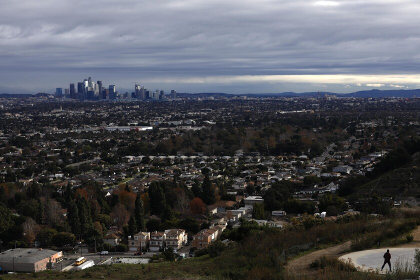 A storm passes over the downtown Los Angeles skyline, as seen from the Baldwin Hills Scenic Overlook in Culver City.