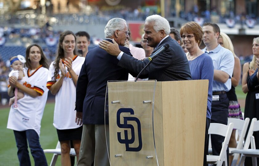 Jerry Coleman is greeted by longtime fellow announcer Ted Leitner as he came to the field to be honored at Petco.