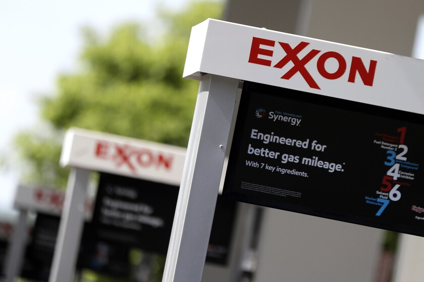 FILE- This April 25, 2017, file photo, shows Exxon service station signs in Nashville, Tenn. New Yor