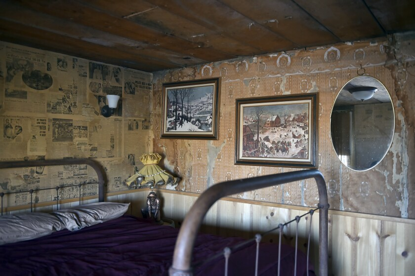 Historic newspapers and other vintage items decorate one the guest rooms in Gold Point, Nev.
